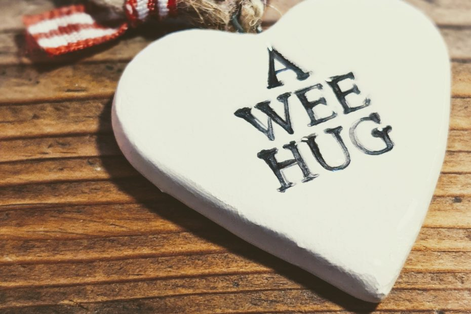"""a heart ornament that says """"a wee hug"""""""